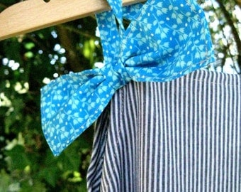 Blue overalls to stripes and bow tie
