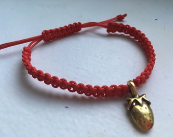 Red bracelet with Golden Strawberry