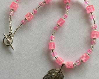 A beautiful pink beaded necklace