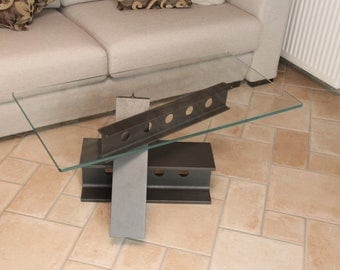 Coffee table with beams and glass