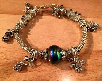 Handmade silver bangle with gemstones and lampworked glass focal bead