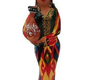 An original statuette of a ceramic Uzbek girl. A ceramic figurine made of clay
