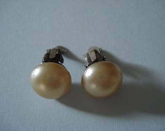 Pair of vintage pearl clip on earrings with silver setting