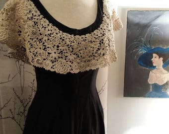 1950s vintage black wiggle dress with ivory lace collar and big bow at the back