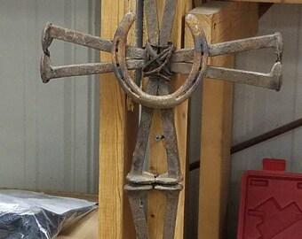 Railroad spike and horseshoe cross