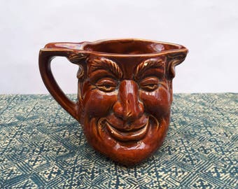 Two faced Toby jug