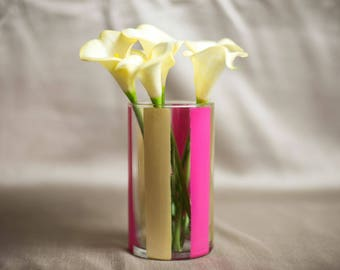 Pink and gold striped glass vase.