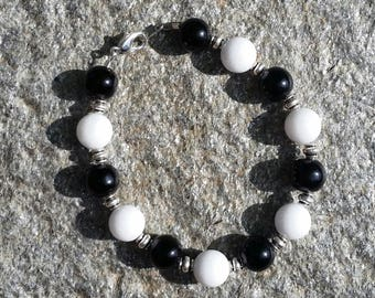Black and white bracelet with silver accents