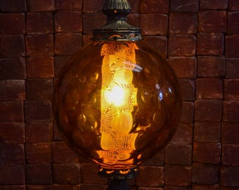 Gorgeous large amber hanging globe lamp which will add the right touch of ambiance to your home or bar. Convo for shipping quote.