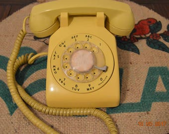 Vintage yellow rotary telephone