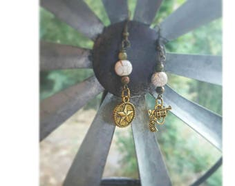 Rustic gun and star dangle earrings