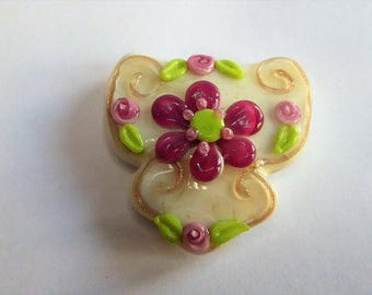 Focal glass lampwork bead in ivory decorated in aventurine, pink and green.