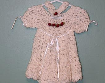 Girls one of a kind hand made crotchet dress in white, adorned by crystals and rosebuds with matching band