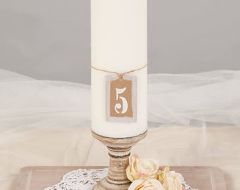 Set of 12 hand painted/stencilled rustic table numbers. Recycled brown card.