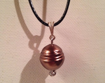 Dyed chocolate shell pearl with cz gem post