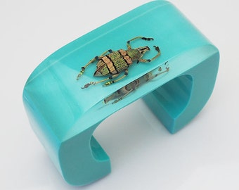 Large blue lucite cuff bracelet with exotic real beetle