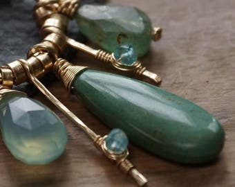 Golden pendant Ocean Blue with blue and green gemstones