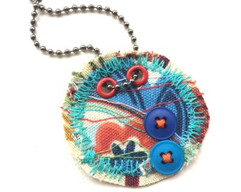 Unique stitched fabric necklace with blue buttons