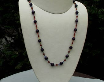 Glass LGBTQ necklace hand knotted on silk 22 1/4 inches