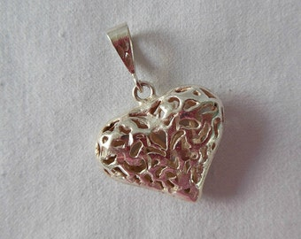 Carved Openwork Silver Heart Pendant