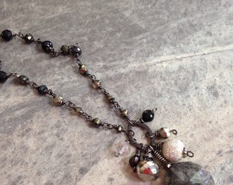 Rutilated quartz and pyrite necklace on black sterling silver chain