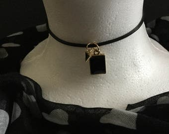 Handmade black single round cord choker necklace with a black charm.