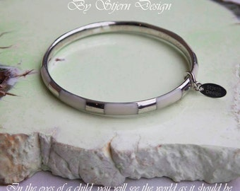 In the eyes of a child, you will see the world as it should be. Hand Engraved Bangle by Stjern Design. Gift for her