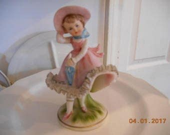 Vintage Porcelain Figurine Girl in pink holding an umbrella Ardco Fine Quality Dallas Made in Japan