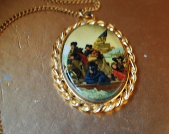 Americana vintage 70s gold tone metal necklace with a cameo pendant, featuring George Washington crossing the Delaware.