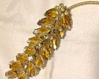 Vintage Gold and Yellow Rhinestone Leaf Shaped Brooch with Marquise and Round Rhinestones Set in Goldtone Metal. 3 3/4 Inches Long.  (D13)