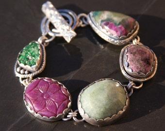 uvarovite garnet druzy, ruby, emerald, eudialyte, ruby in fuchsite, and sterling silver metalwork link bracelet