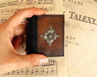 Worn Little Book / Leather Journal with brass decoration