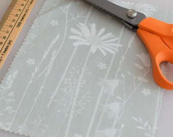 A5 sample of daisy meadow fabric in sage green