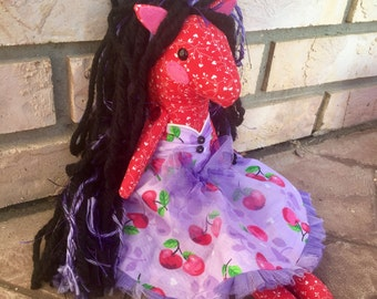 Handmade plush pony. Button jointed arms. Yarn mane and tail. Stuffed horse doll with Rockabilly dress