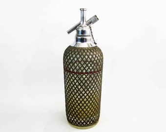 Antique Glass Seltzer Bottle with Woven Metal Mesh Cover. Circa 1920's.