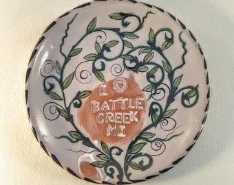 Round ceramic decorative trays - whimsical hand painted -souvenirs from Battle Creek Michigan - majolica pottery