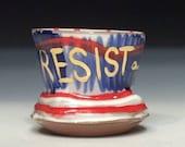 Wavy line resist cup
