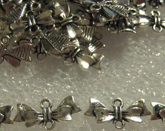 Tibetan Silver Bow Pendants for Earrings and other Jewelry Projects - 70 pc approximately