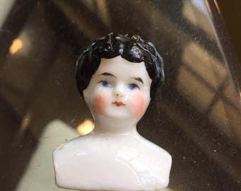 Vintage small porcelain dolls head