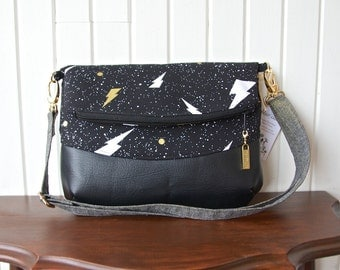 Freesia Foldover Cross body bag in  Bolt Thrower in black with black faux leather