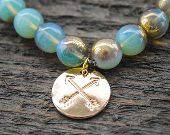 Friendship Bracelet - Crossed Arrow Charm - Milky Peridot with Gold Beads - Stretch Bracelet - One Size Fits Most