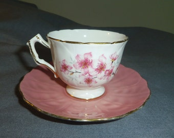 Aynsley Teacup and Saucer, Footed Cup, Cherry Blossoms with Pink Saucer 1939 - 1950s