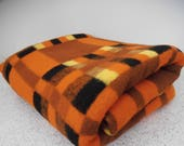 checks in orange, tan and black...vintage acrylic single bed blanket