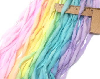 Pastel rainbow yarn handspun self striping and thick and thin in merino wool - 58 yards, 2.9 ounces/83 grams