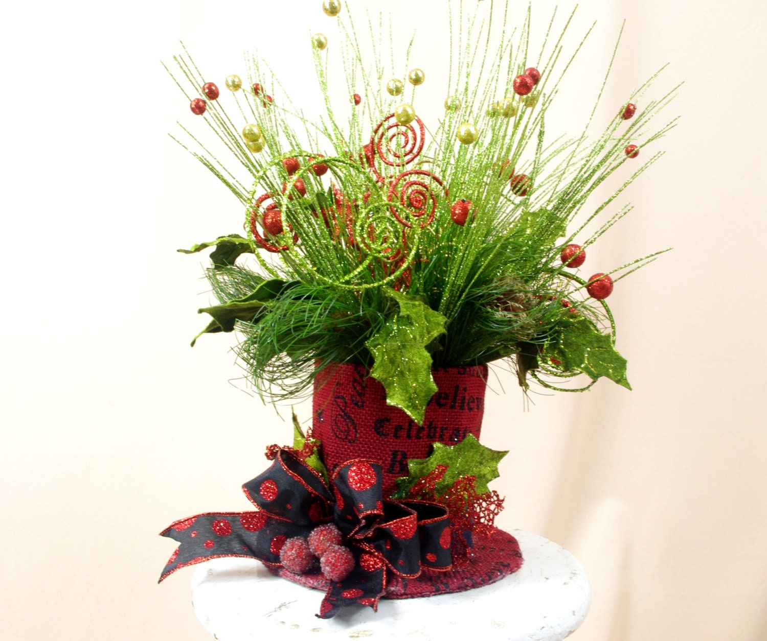 Red top hat christmas centerpiece and green arrangement