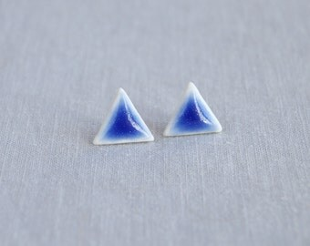 TRIANGLE stud earrings. White porcelain, cobalt blue ceramic glaze, surgical steel posts, trending geometric jewellery