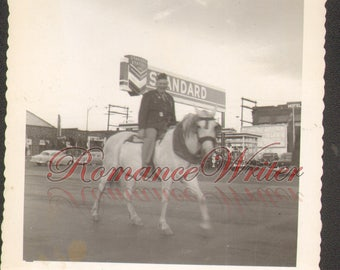 Man on Horse in front of Standard Oil Sign Vintage Photo Parade Photo