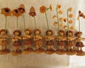 Vintage springtime flower holding wood wood composite girl figurines.  Lot of 8 figurine.