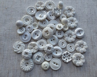 Vintage assorted size and design white plastic buttons. Lot of 1000 buttons.
