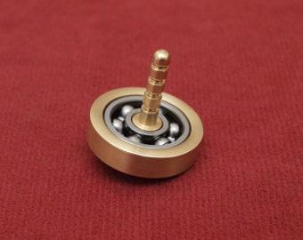 Roller bearing spinning top, lathe turned brass EDC